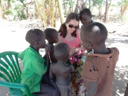 Always a teacher... helping out children with some extra homework during a teaching visit to South Sudan.
